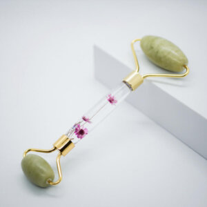Gezichtsroller jade edelsteen met bloemenhandvat